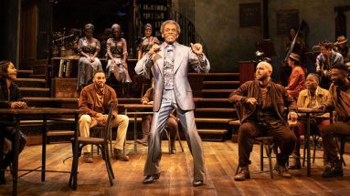 André De Shields and company in Hadestown. Photo by Helen Maybanks